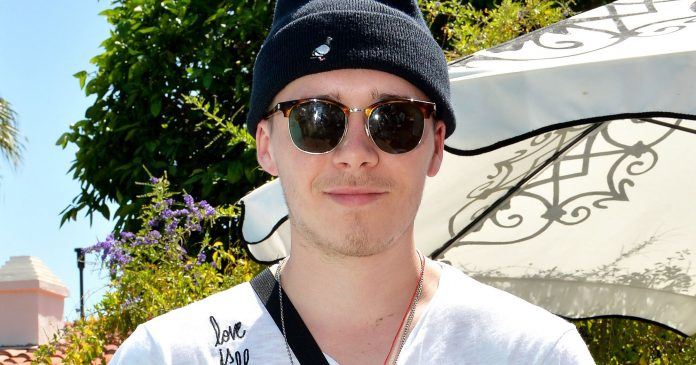 A Guide To Brooklyn Beckham's Dainty, Dad-Inspired Tattoos