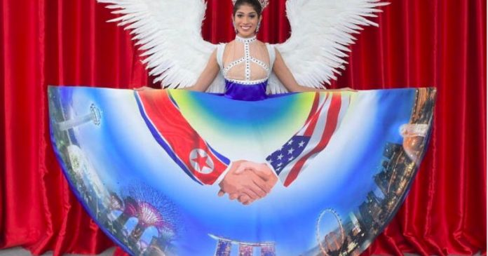 Miss Universe Singapore's pageant dress is a giant mural of Trump and Kim Jong Un shaking hands