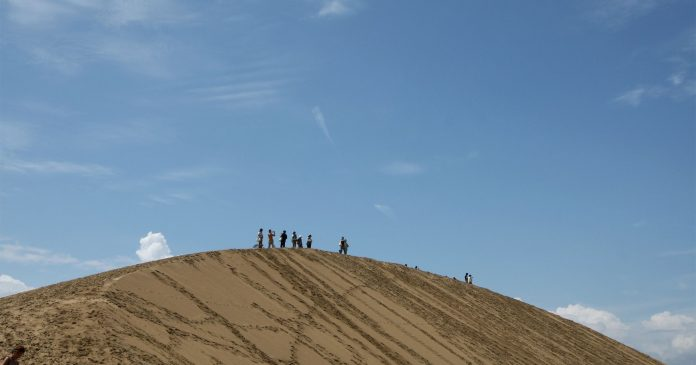 Tourists Are Defacing The Tottori Sand Dunes In Japan — & Officials Aren't Happy