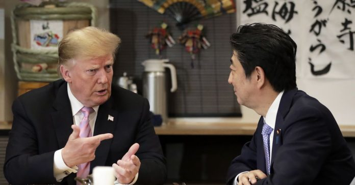 In Japan, Trump pushes a hard line on trade — and a soft line on North Korea