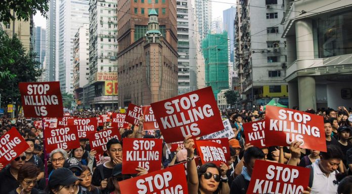 Huge Hong Kong protests continue after the government postpones controversial bill