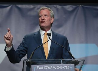 Bill de Blasio faces criticism for campaigning in Iowa during New York's blackout