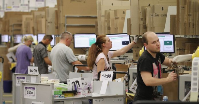Amazon warehouse workers in Chicago say the company cheated them of overtime hours