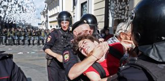 Russian police crack down on protesters during the largest demonstrations in a decade
