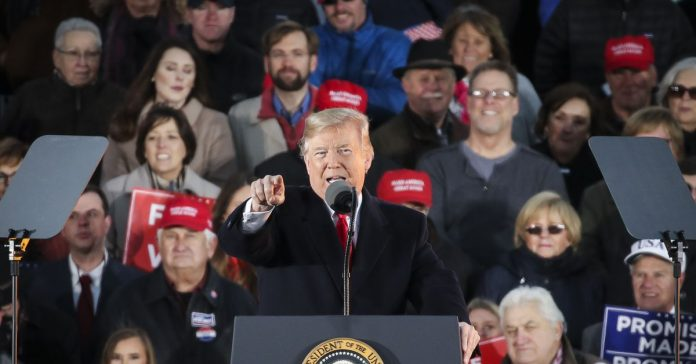 Trump stumps for himself during a Mississippi rally for a tight governor's race
