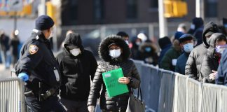 Covid-19 patients are flooding New York hospitals, and the peak may be 3 weeks away