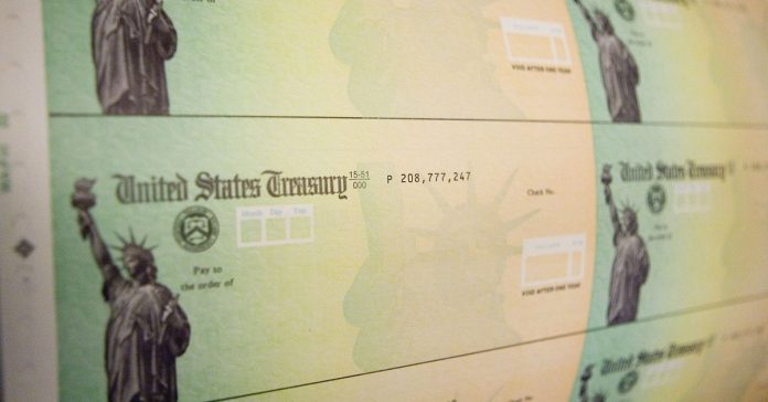 US citizen spouses and children of unauthorized immigrants were shut out of stimulus relief. Now they're suing.