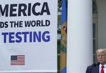 """Trump's White House banner claims """"America leads the world in testing."""" That's wrong."""