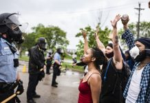 Photos capture the stark contrast in police response to George Floyd protests vs. anti-lockdown protests