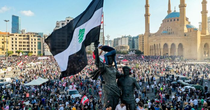 """Thousands of protesters in Beirut call for """"the fall of the regime"""" in the wake of the blast"""