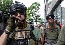 Facebook banned violent militia groups. We still found plenty of them on its platform.
