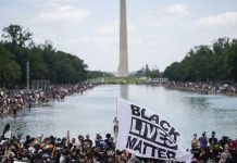"""The """"Get Your Knee Off Our Necks"""" March on Washington in photos"""