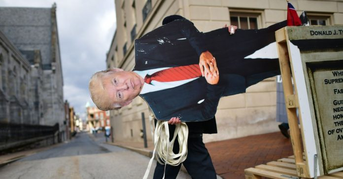 On his last full day in office, Trump sinks to his lowest low in major polls