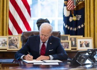 Biden just partially lifted Trump's pandemic-related restrictions on legal immigration
